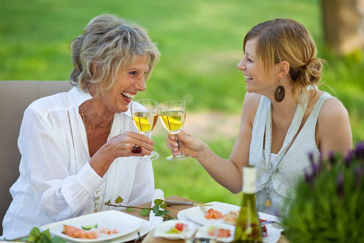 botox-juvederm-patients-sipping-wine-together