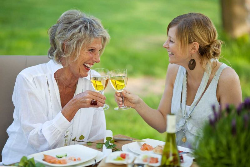two-houston-dental-implant-patients-drinking-wine