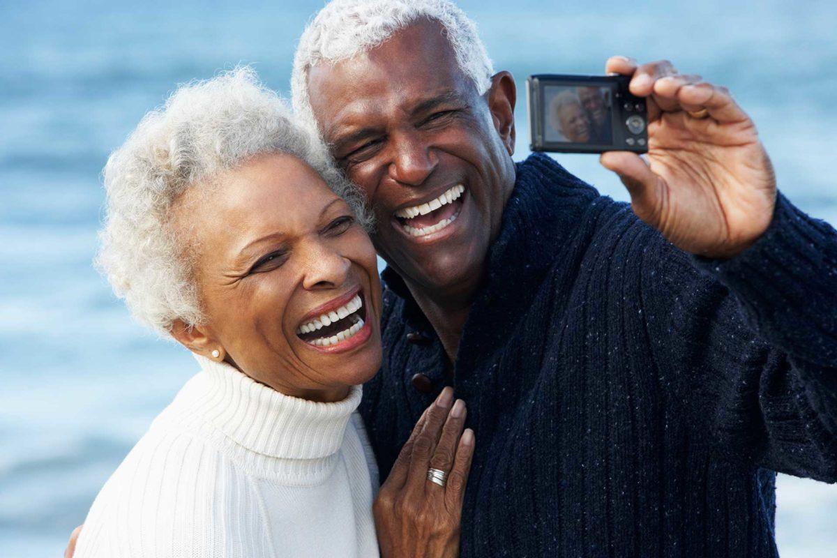 older houston dental implant couple taking selfie